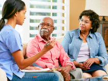 Caregiver talking with the elders