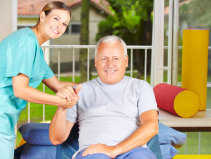 Caregiver and elder doing physical therapy